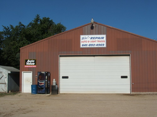 Mike's Repair storefront. Your local The Merrill Co. in Chaplin, IA.